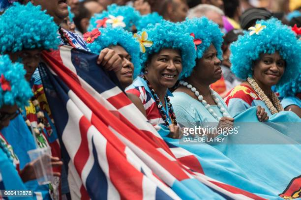 Fiji supporters celebrate during their match against Australia during the final day of the Hong Kong Rugby Sevens tournament on April 9 2017 / AFP...