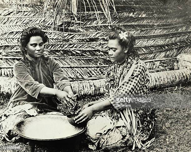 Two Fijian women making the narcotic beverage Kava a favorite food Undated photograph