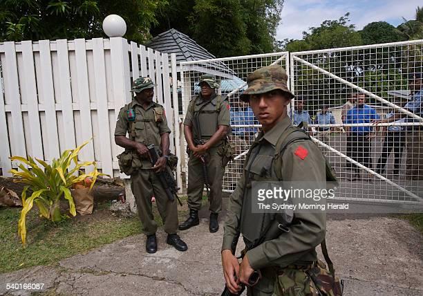 Fiji Unrest Soldiers including Meli Bainimarama front the son of Fiji's military chief Frank Bainimarama surround the residence of the Fijian Prime...