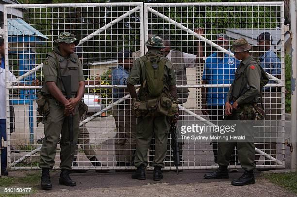 Fiji Unrest Soldiers including Meli Bainimarama right the son of Fiji's military chief Frank Bainimarama surround the residence of the Fijian Prime...