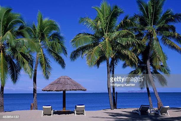 Fiji, Viti Levu Island, Sheraton Denarau Villas Hotel, Beach, Coconut Palm Trees With Straw Umbrella.