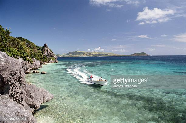fiji, yasawa island, people in boat on ocean - fiji stock pictures, royalty-free photos & images