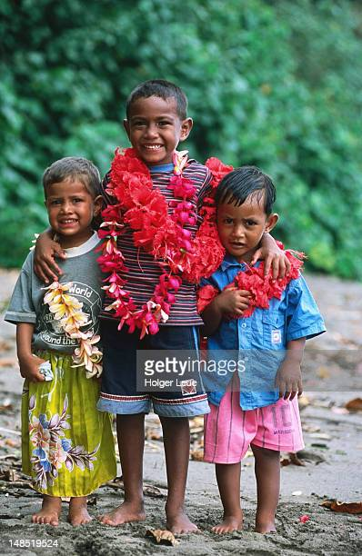 Fijian boys with flower leis, Navakacoa.