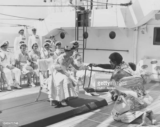 A Fijian chief performing a traditional invitationtoland ceremony for Queen Elizabeth II aboard the SS Gothic in Suva Bay during the coronation world...