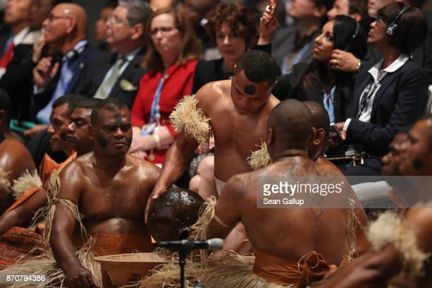 Fijian cultural group perfomrs a ceremony at the opening session of the COP 23 United Nations Climate Change Conference on November 6 2017 in Bonn...