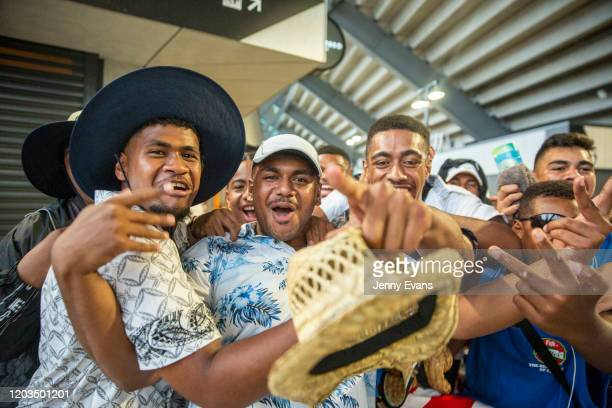 Fijian fans cheer as they pose for a photo in the concourse as rain falls during the 2020 Sydney Sevens match between Fiji and England at Bankwest...