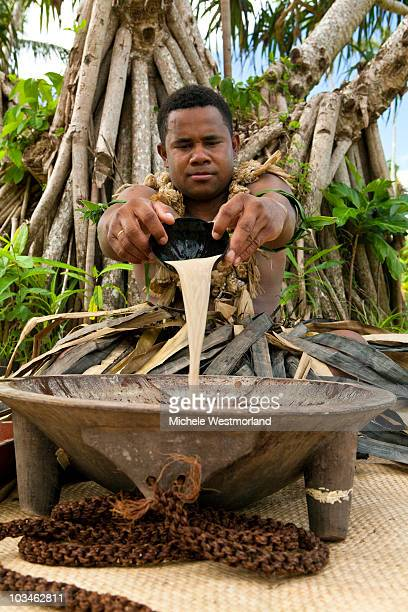 Fijian Man Preparing Traditional Kava Drink