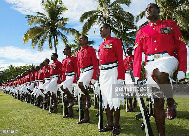 Fijian military police wearing traditional sulus form a guard of honour during the welcome ceremony for the delegates of the 3rd African Caribbean...