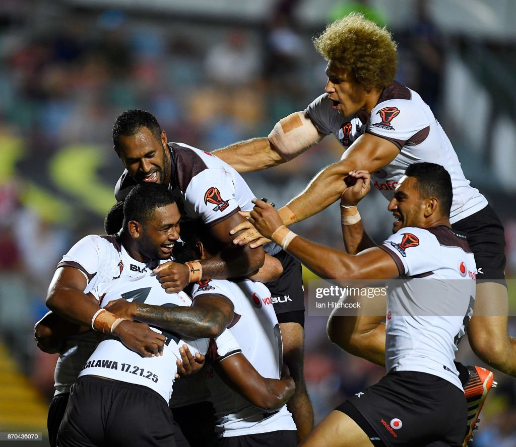 Fijian players celebrate the try of Joe Lovodua of Fiji during the 2017 Rugby League World Cup match between Fiji and Wales at 1300SMILES Stadium on November 5, 2017 in Townsville, Australia.