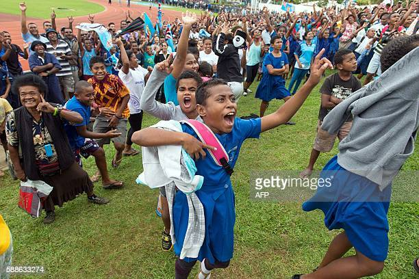 Fijians celebrate the victory of their Sevens rugby team against Britain in the final at the Rio Olympics inside ANZ stadium in Suva on August 12...