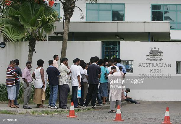 Fijians queue outside the Australian High Commission to apply for travel visas following Fiji's fouth coup in twenty years December 7 2006 in Suva...