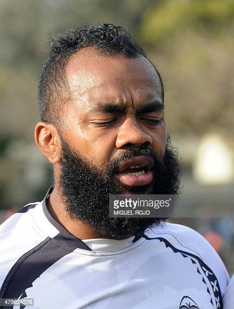 Fiji's Apisai Naikatini sings his national anthem before a friendly match against Uruguay ahead of the 2015 England Rugby World Cup in Montevideo on...
