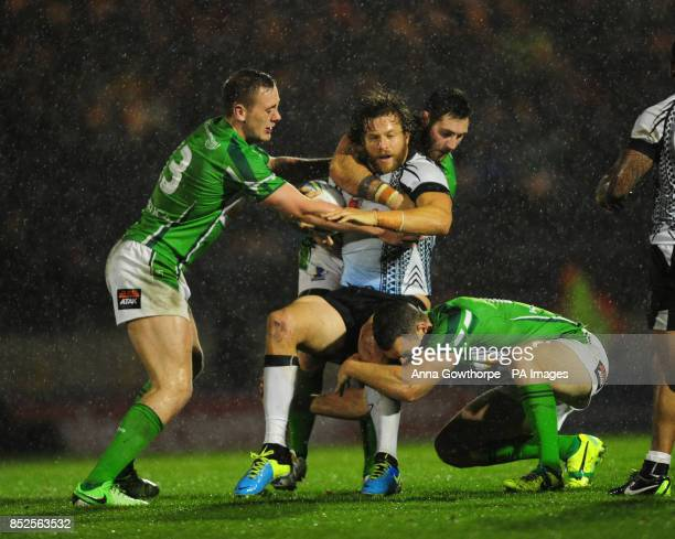 Fiji's Ashton Sims is tackled by Ireland's Ben Currie Kurt Haggerty and James Hasson during the 2013 World Cup match at Spotland Rochdale