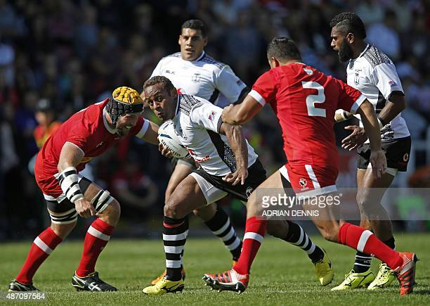 Fiji's centre Gabiriele Lovobalavu is tackled by Canada's number 8 Richard Thorpe and Canada's hooker Benoit Piffero during the international rugby...