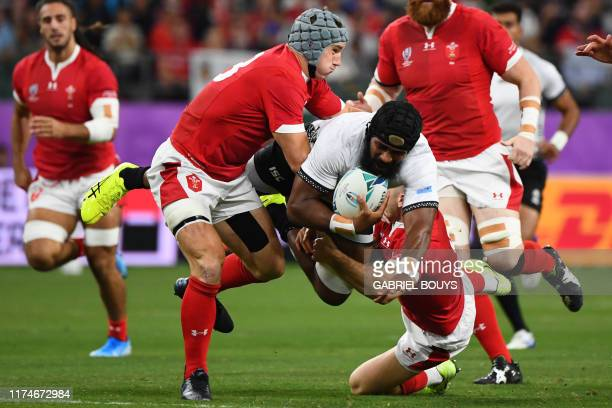 Fiji's flanker Dominiko Waqaniburotu is tackled during the Japan 2019 Rugby World Cup Pool D match between Wales and Fiji at the Oita Stadium in Oita...