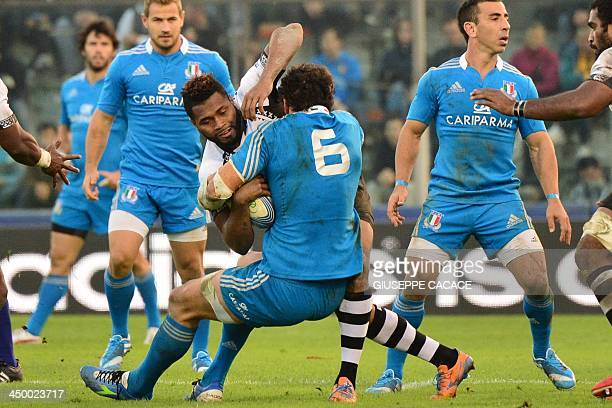 Fiji's fullback Metuisela Talebula fights for the ball with Italy's flanker Alessandro Zanni during the rugby test match between Italy and Fiji on...