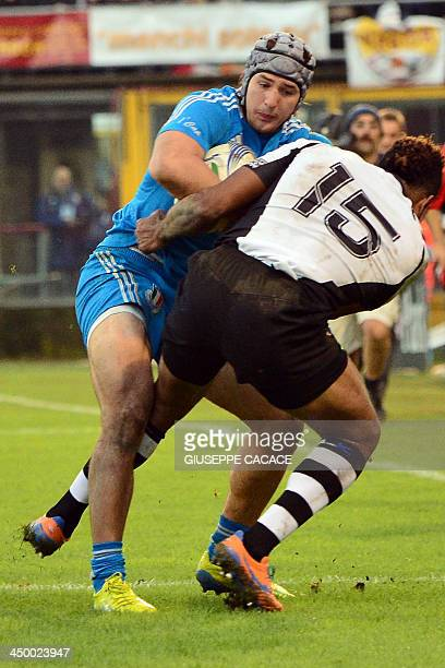 Fiji's fullback Metuisela Talebula fights for the ball with Italy's centre Michele Campagnaro during the rugby test match between Italy and Fiji on...