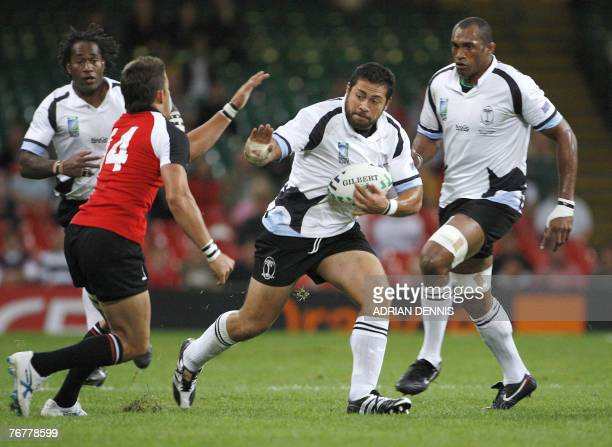Fiji's Graham Dewes vies with Canada's Dth Van Der Merwe during the rugby union World Cup group B match Fiji vs Canada 16 September 2007 at the...