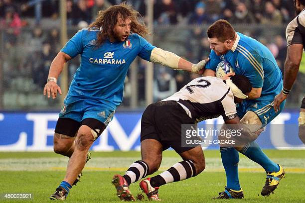 Fiji's hooker Viliame Veikoso fights for the ball with Italy's prop Martin Castrogiovanni and Italy's prop Michele Rizzo during the rugby test match...