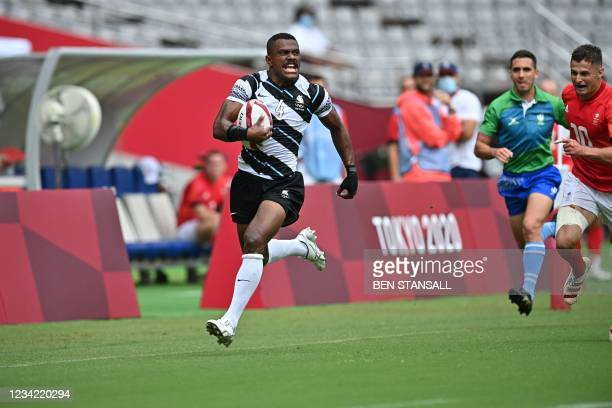 Fiji's Jiuta Wainiqolo runs for the try in the men's pool B rugby sevens match between Fiji and Britain during the Tokyo 2020 Olympic Games at the...