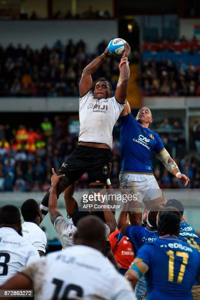Fiji's lock Leone Nakarawa and Italy's number 8 Sergio Parisse jump for the ball in a line out during a rugby union test match between Italy and Fiji...