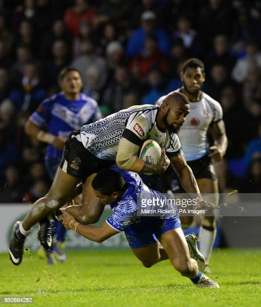 Fiji's Marika Koroibe is tackled by Samoa's Anthony Milford during the World Cup Quarter Final at the Halliwell Jones Stadium Warrington