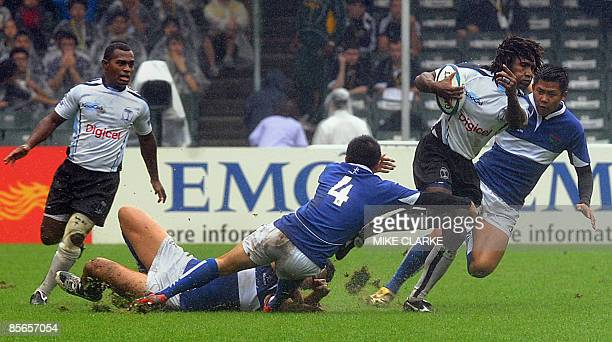 Fiji's Nasoni Roko runs for a try against Taiwan during the first day of the Hong Kong Rugby Sevens the fifth leg of the IRB World Sevens Series on...