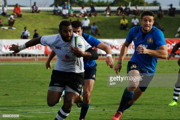 Fiji's Nemani Naqusa runs with the ball during their international rugby test match between Fiji and Italy in Suva on June 17 2017 Fiji conjured a...