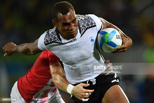 TOPSHOT Fiji's Osea Kolinisau scores a try in the mens rugby sevens gold medal match between Fiji and Britain during the Rio 2016 Olympic Games at...