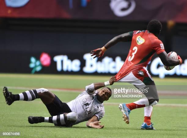 Fiji's Paula Dranisinukula slows the pace of Kenya's Samuel Ngethe during the HSBC Canada Men's Sevens in BC Place Stadium in Vancouver BCCanada...