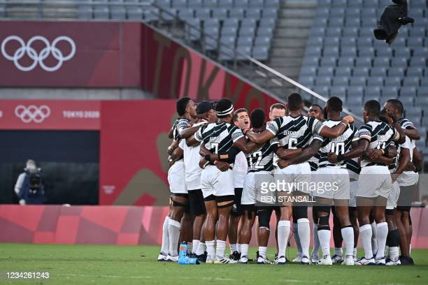 Fiji's players celebrate winning the men's final rugby sevens match between New Zealand and Fiji during the Tokyo 2020 Olympic Games at the Tokyo...