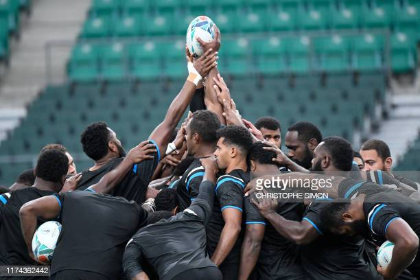 Fiji's players take part in a group gathering during a captain's run training session at the Oita Stadium in Oita on October 8 on the eve of their...