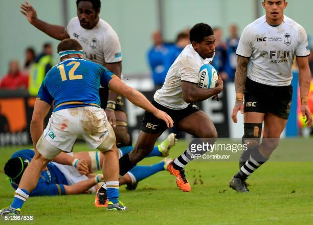 Fiji's scrumhalf Frank Lomani runs with the ball during the international rugby union Test match between Italy and Fiji at The Angelo Massimino...