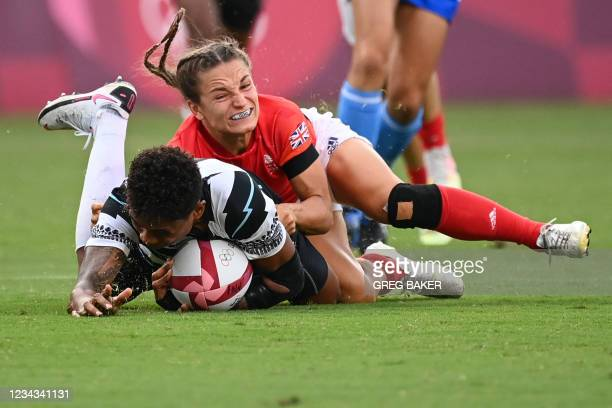 Fiji's Vasiti Solikoviti is tackled by Britain's Jasmine Joyce in the women's bronze medal rugby sevens match between Fiji and Britain during the...