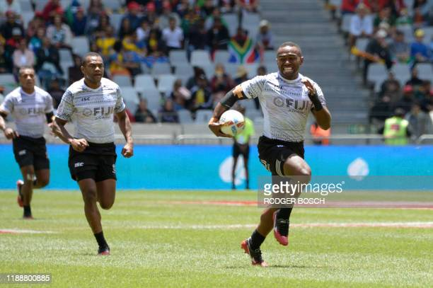 Fiji's Waisea Nacuqu runs with the ball during the HSBC World Rugby Sevens Series men's quarter final rugby match between Fiji and Ireland at the...