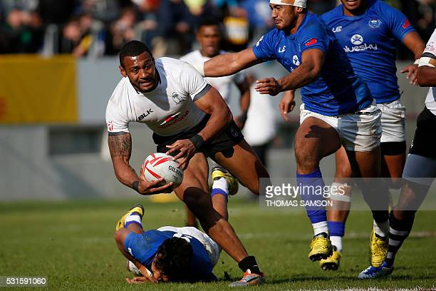 Fiji's Waisea Nayacalevu runs with the ball during the HSBC Paris Sevens Series final rugby match between Samoa and Fiji at the Stade Jean Bouin in...