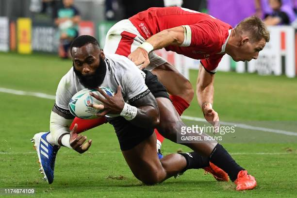 Fiji's wing Semi Radradra is tackled by Wales' full back Liam Williams during the Japan 2019 Rugby World Cup Pool D match between Wales and Fiji at...
