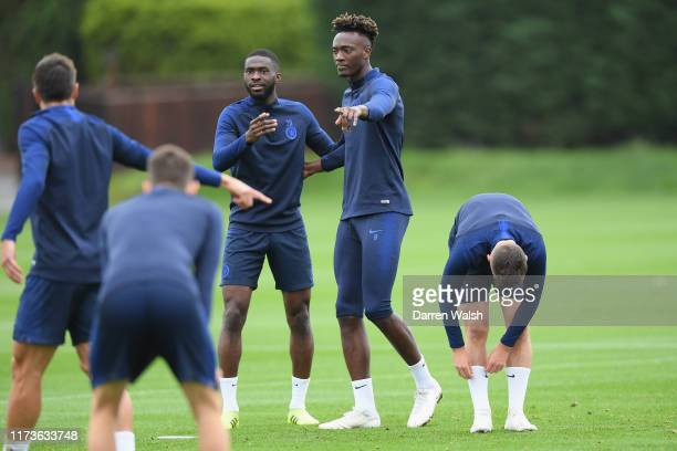 Fikayo Tomori and Tammy Abraham of Chelsea during a training session at Chelsea Training Ground on October 4 2019 in Cobham England
