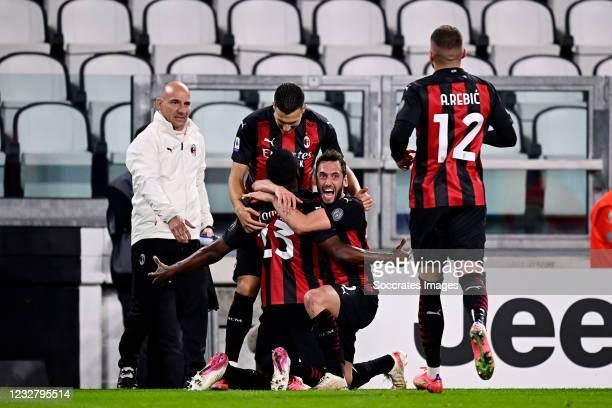 Fikayo Tomori of AC Milan Celebrates 0-3 with teammates Hakan Calhanoglu of AC Milan, Diogo Dalot of AC Milan during the Italian Serie A match...