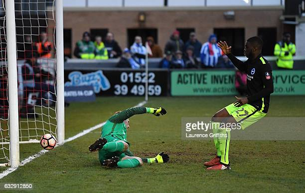 Fikayo Tomori of Brighton and Hove Albion scores an own goal during the Emirates FA Cup Fourth Round match between Lincoln City and Brighton and Hove...