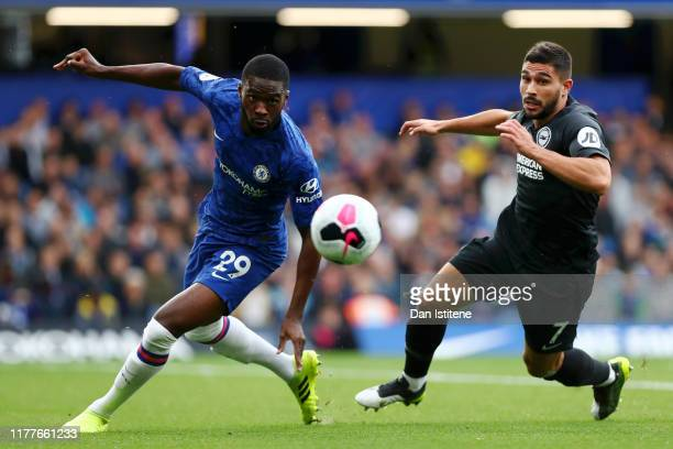 Fikayo Tomori of Chelsea and Neal Maupay of Brighton and Hove Albion chase the ball during the Premier League match between Chelsea FC and Brighton...