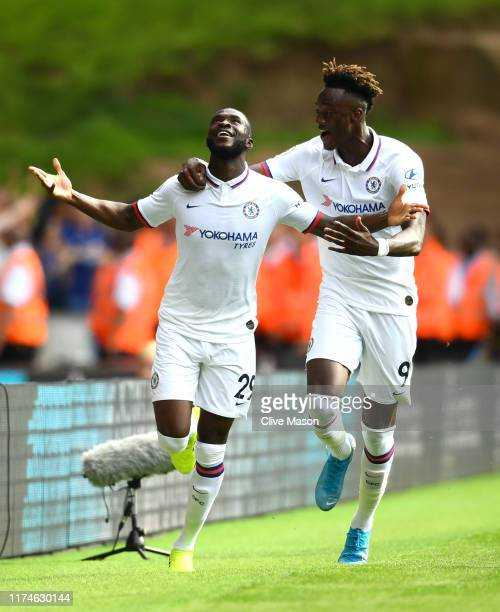 Fikayo Tomori of Chelsea celebrates with teammate Tammy Abraham after scoring his team's first goal during the Premier League match between...