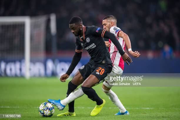 Fikayo Tomori of Chelsea challenges for the ball with Hakim Ziyech of Amsterdam during the UEFA Champions League group H match between AFC Ajax and...