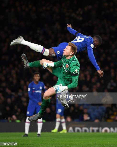 Fikayo Tomori of Chelsea clashes with David Martin of West Ham United during the Premier League match between Chelsea FC and West Ham United at...