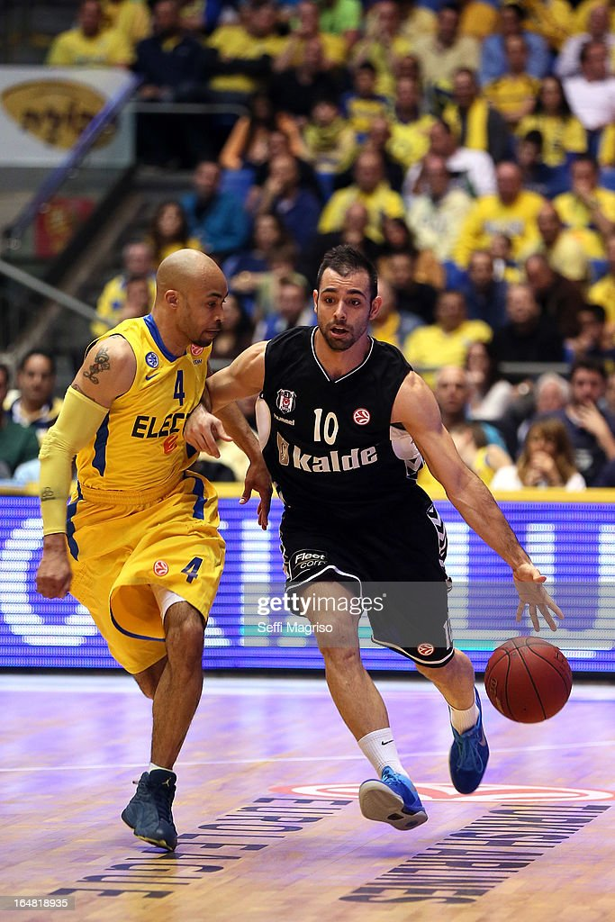Fikret Can Akin, #10 of Besiktas JK Istanbul competes with David Logan, #4 of Maccabi Electra Tel Aviv in action during the 2012-2013 Turkish Airlines Euroleague Top 16 Date 13 between Maccabi Electra Tel Aviv v Besiktas JK Istanbul at Nokia Arena on March 28, 2013 in Tel Aviv, Israel.