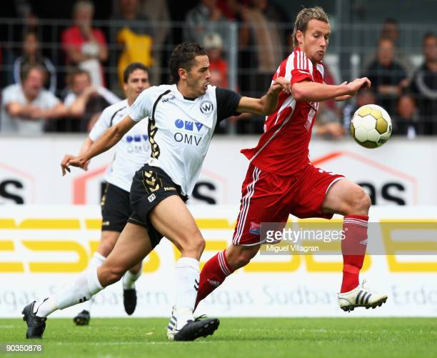 Fikri El Haj Ali of Wacker Burghausen and Manuel Konrad of SpVgg Unterhaching challenge for the ball during the 3 Liga match between Wacker...
