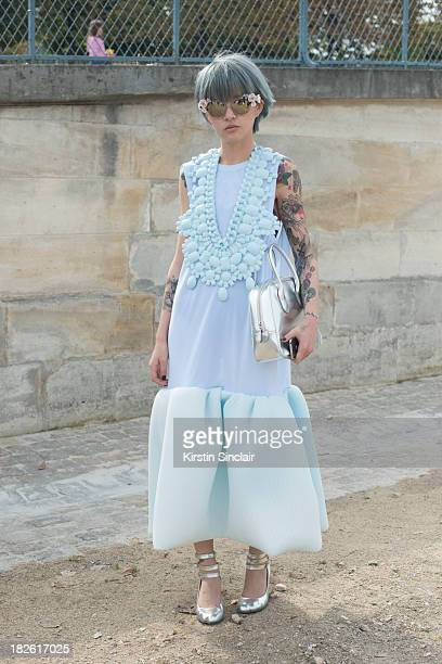 Fil wearing a Li Xiao dress, Dolce and Gabanna sunglasses, Vivienne Westwood shoes and a Comme Des Garcons bag on day 8 of Paris Fashion Week...