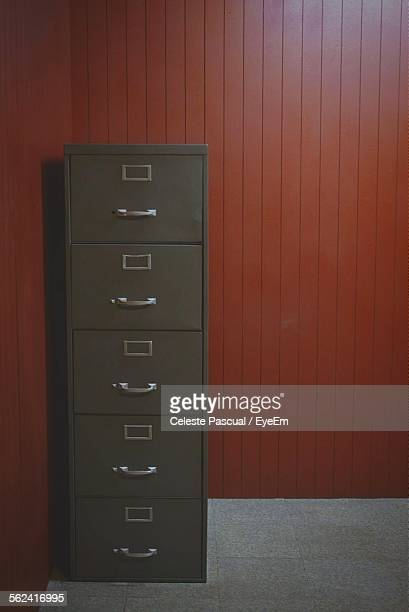 File Cabinet Standing Under Wall
