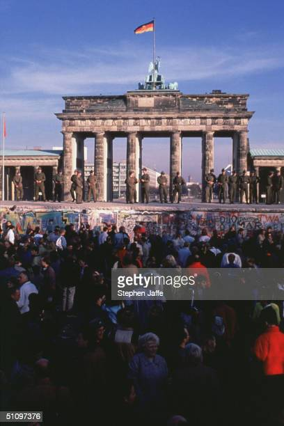 A Crowd Of West Germans Gather In Front Of The Brandenburg Gate On News Of The Berlin Wall Being Lifted During The Collapse Of Communism In East...