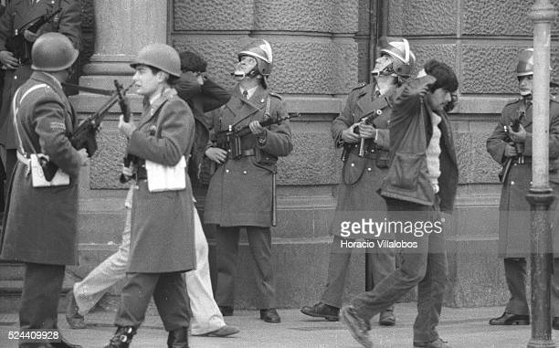 Group of Allendes bodyguards are held prisoners by Carabineros, across the street from La Moneda. All of them were killed later. Photographed in the...